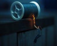 hängande tråd arkivfoton