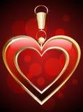 Hänge i forma av en röd hjärta Fotografering för Bildbyråer