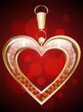 Hänge i forma av en röd hjärta Royaltyfria Bilder