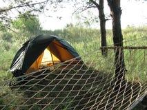 Hängematte und Zelt Stockfotos
