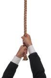 Hängen am Ende des Seils Stockfotografie