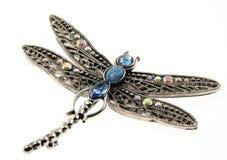 Hängende Schmucksachen der Libelle getrennt auf Weiß Stockfoto