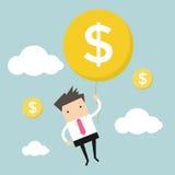 Hängender Geldballon des Geschäftsmannes Stockfotos