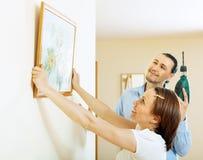 Hängendes Kunstbild des Mannes und der Frau Lizenzfreies Stockbild