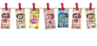Hängendes mexikanisches Geld Lizenzfreie Stockfotos