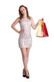 Hänger lös bärande shopping för kvinnan Arkivfoto