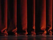 hänger upp gardiner den röda theatren royaltyfri bild