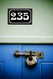 Hänglås och nummer 235 Royaltyfria Bilder