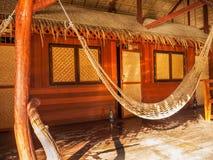 Hängmatta framme av en koja, Thailand Royaltyfri Foto