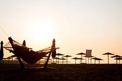 Hängmatta på stranden royaltyfria bilder