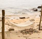 Hängmatta på stranden Arkivfoton
