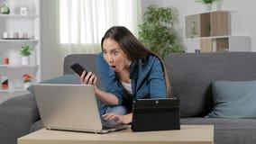 Häpen kvinna som använder åtskilliga apparater stock video