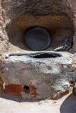 Härden i borggården av grottahuset av grottmänniskor fotografering för bildbyråer
