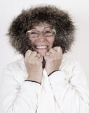Härlig äldre kvinna i vita winterclothes Arkivbilder