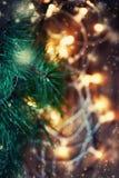 Härlig abstrakt snöflingajulbakgrund med ljus Royaltyfri Fotografi