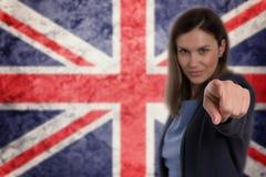 Härlig affärskvinna som pekar hennes finger på dig tysk flagga b Royaltyfria Foton