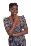 Härlig afrikansk kvinna med traditionell kläder Arkivbild