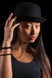 Härlig asiatisk flicka i hatt Royaltyfri Fotografi