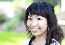 Härlig asiatisk kvinna Arkivfoto