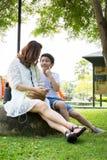 Härlig asiatisk kvinna med din son Arkivbild