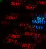 Härlig bakgrund med det olika kulöra numret 2017, abstrac Arkivbild