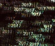 Härlig bakgrund med det olika kulöra numret 2017, abstrac stock illustrationer