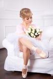 Härlig ballerina med blommor Royaltyfria Bilder