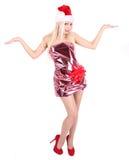 Härlig blond flicka i den Santa hatten och blank klänning Royaltyfria Bilder