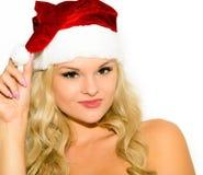 Härlig blond flicka i ett lock av Santa Claus Royaltyfria Bilder