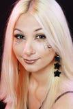Härlig blond flicka med det halloween sminket Arkivbild
