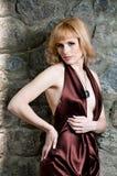 härlig blond klänningaftonflicka Royaltyfria Bilder