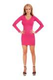 Härlig blond kvinna i rosa klänning Arkivbilder