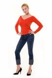 härlig blond röd tröja royaltyfri fotografi