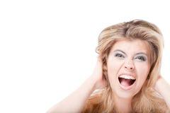 härlig blond skrikig kvinna royaltyfria foton