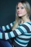 härlig blond tröja royaltyfria bilder