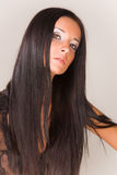 härlig brunetflicka Arkivfoto