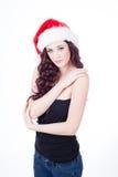 Härlig brunett i den Santa hatten Royaltyfria Foton