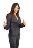 härlig brunettaffärskvinna som ger upp tum Royaltyfri Foto