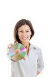 Härlig caucasian tillfällig le hållande övre CD-SKIVA för kvinna Royaltyfria Foton