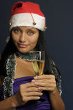 härlig champagnejul som dricker kvinnan Arkivbild