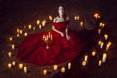 Härlig dam med stearinljus Royaltyfria Bilder