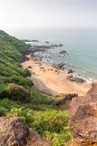 Härlig dold Colastrand, Goa, Indien royaltyfri bild