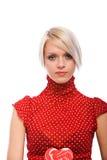 Härlig elegant blond kvinna i en röd överkant royaltyfria foton