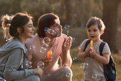 Härlig familj med ett barn royaltyfria bilder