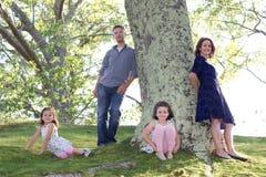 Härlig familj utanför Royaltyfria Bilder