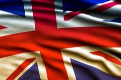 Härlig flagga av UK som vinkar i vinden Arkivbild