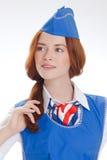Härlig flicka i blåa likformig Royaltyfri Foto
