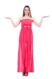 Härlig flicka i den rosa långa klänningen som isoleras på Royaltyfri Fotografi