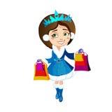 Härlig flicka i en blå dräkt rymma jul som shoppar i deras händer Arkivbild