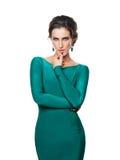 Härlig flicka i en blå klänningstående Arkivfoton